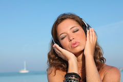 woman-beach-music-headphones-12387004